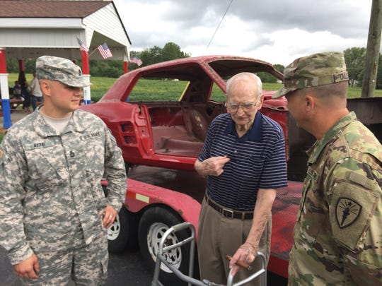 Harry Donovan, center, talks with Indiana National Guard members Allen Alte of Greenwood, left, and Dan Tallent of Indianapolis.
