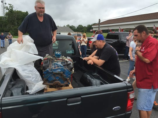 Chris Howsley of Fairland showed up at a fundraiser   in Danville on Saturday with a Ford engine to donate to the restoration project.
