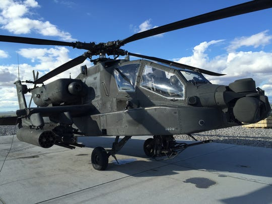 An Apache attack helicopter gets ready to take off