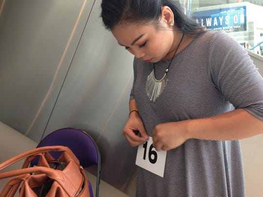 Mary Grace Lim safety-pins her number before the audition.