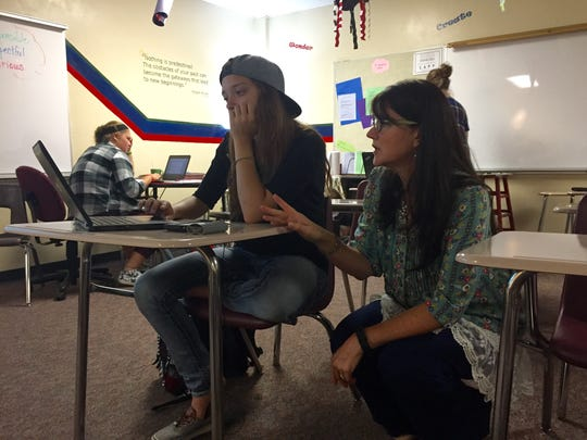 Neenah High School teacher Tara Rockweit helps Brittney Vestal, a senior, in a class that allows students to explore careers in education.