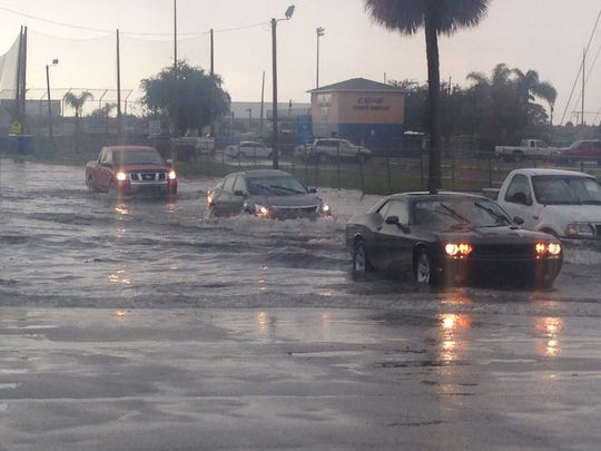 Commodore and Aurora streets in Melbourne flood from a tropical wave pummeling Brevard in September 2016.