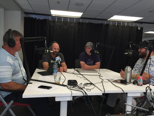 Hosts Jeff Baker and Jason Strempek talk with Chris Maloney (L) and Lou DiMasi (R), organizers of Oktoberfest Vermont.