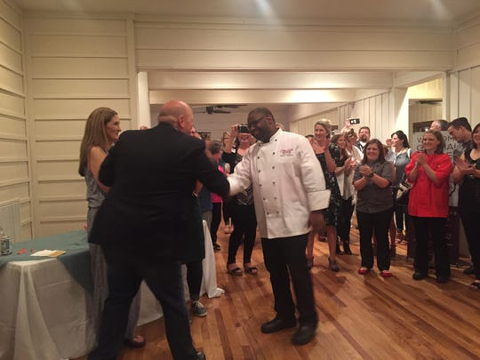 Overall winner Dwayne Ingraham (white coat) is congratulated by Eat Y'all's Andy Chapman at the 2016 Sweetest Chefs of the South competition.
