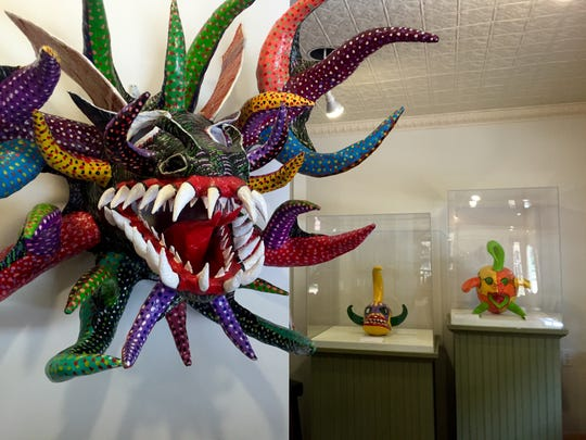 Masks on display at WheatonArts tell the story of Caribbean communities past and present.
