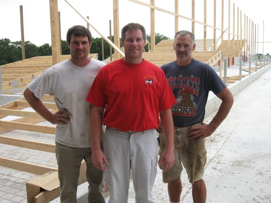 The Loehr brothers are, from left: Mark, Joe and Dan. Together they own Loehr Dairy near Holyland.