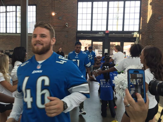 Lions fullback Michael Burton arrives to greet kids