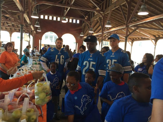 Lions, from left, Michael Burton, Theo Riddick and