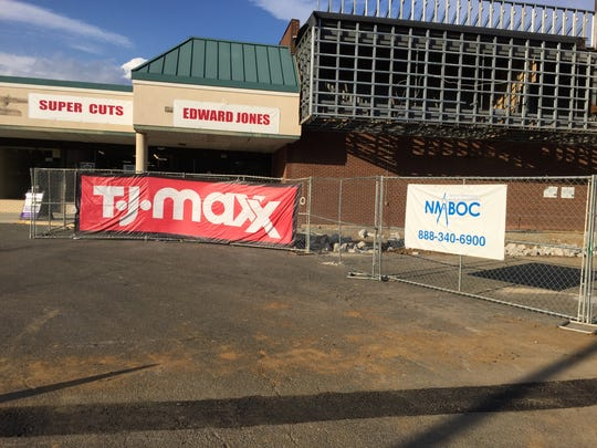 A sign promotes T.J. Maxx, which is moving into the