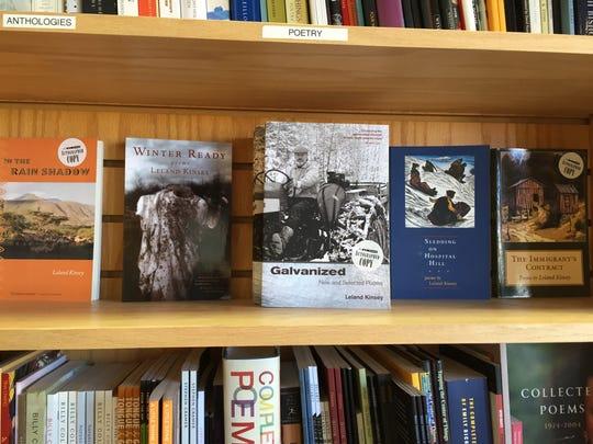 Book of poetry by Leland Kinsey on display at Phoenix Books Burlington.