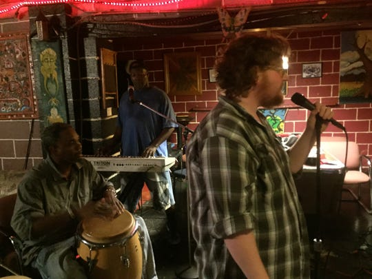 Mitch Oak (front), Donald Wilson (left) and Stanley Robinson (back) during a rehearsal for the Shreveport Common song