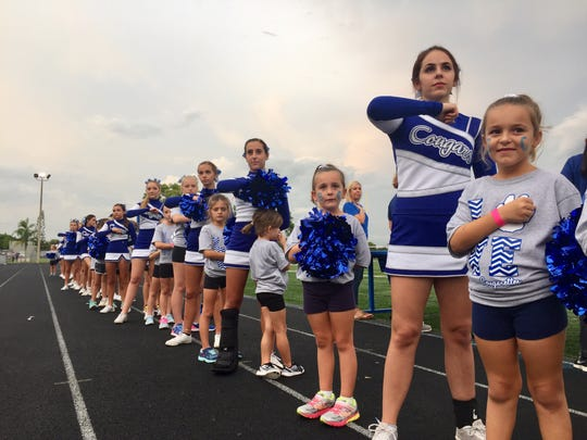 Barron Collier cheerleaders and cougarettes stand during the playing of the national anthem before the game against Lehigh at Barron Collier High School Friday night, September 16, 2016. Darron R. Silva/Special to Naples Daily News