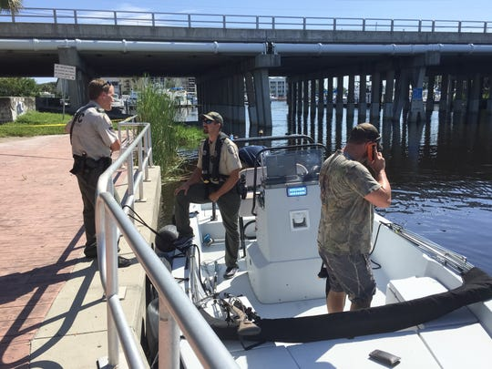 FWC prepare to enter the water to look for an alligator, which attacked a homeless man swimming in Crane Creek on Monday (Sept. 19, 2016)