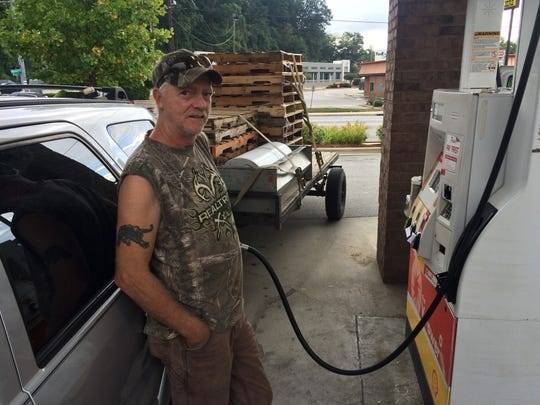 """Wayne Parham fills up his Ford Escape Monday morning at the Citi-Stop Shell station in Biltmore Village. """"I think it's freakin' out,"""" Parham said, when asked what's driving the shortage, but he added that people like him can't work if they don't have gas. Parham buys and sells pallets for a living."""