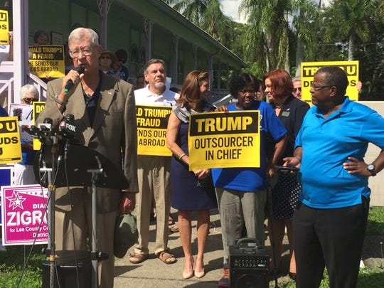 John Douglass, retired brigadier general in the U.S. Air Force, speaks Monday as Clinton supporters and Trump critics look on.