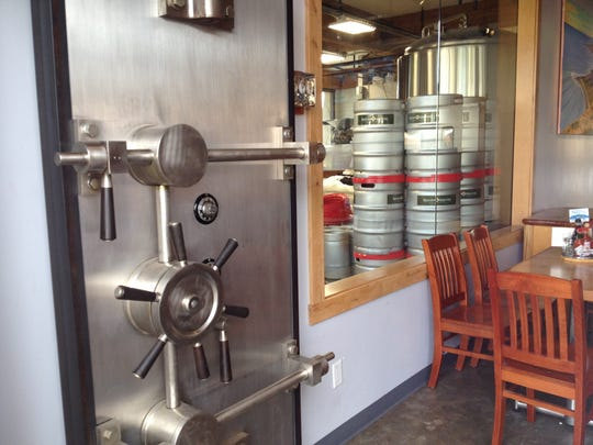 Kegs are stored in the former bank vault at Rincon Brewery in Carpinteria. Owners of the combination restaurant and microbrewery plan to open a second location in Ventura.