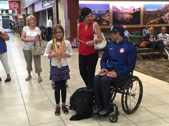 Will Lachenauer with his wife Tanya and daughter Deja at the Reno-Tahoe International Airport on Tuesday.