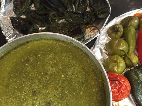 Salsa verde simmers in the South of the Border kitchen, where peppers roast for more sauces and salsa.