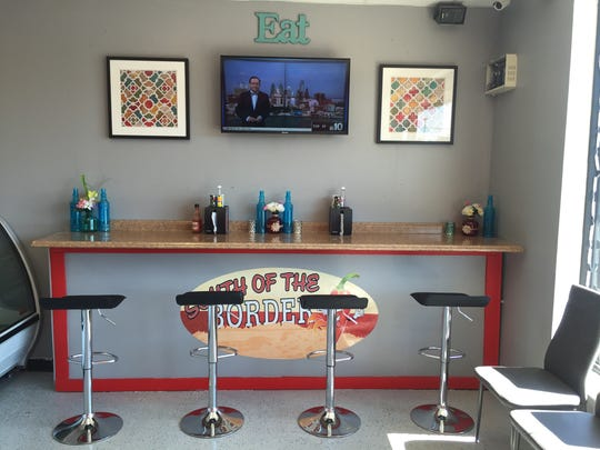A counter awaits customers at South of the Border, but much of the business is take out and delivery.
