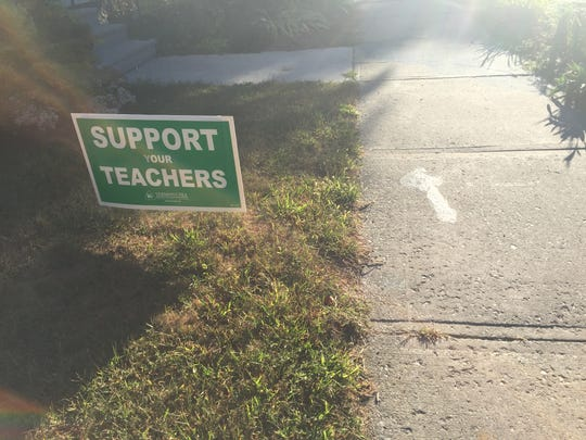 Pro-union lawn signs have sprouted up around Burlington.