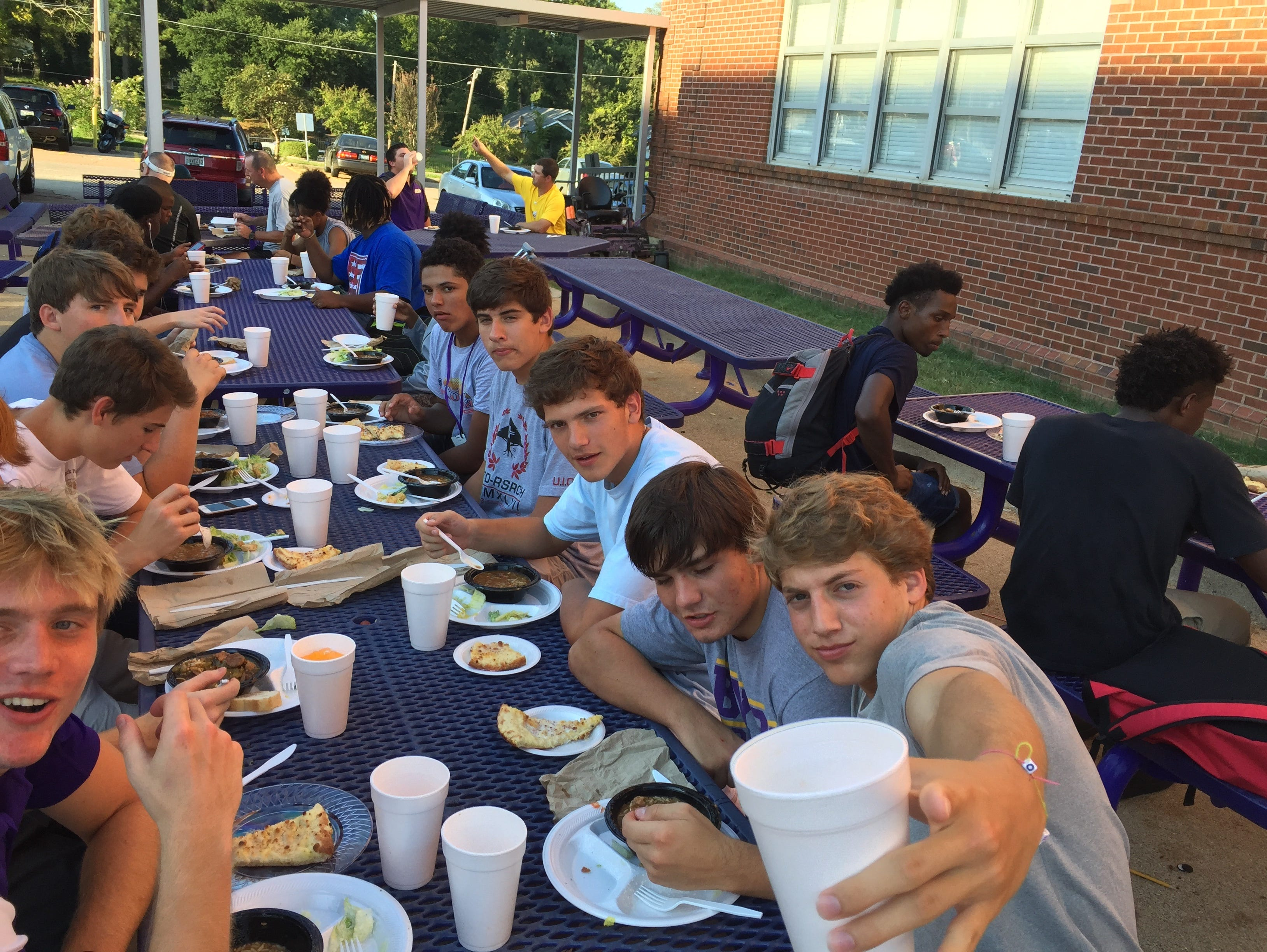 Members of the Byrd football team enjoy a meal on Wednesday following practice at the school. Byrd and Captain Shreve will meet for the 39th time Thursday.