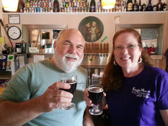 Dan and Sonia Buonodono,  owners of EagleMonk Pub and Brewery, enjoying the 517 Imperial Brown that will be at Beerfest in the Ballpark Friday.