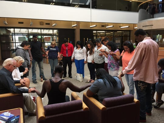 During jury deliberation, the family and supporters of Elijah Arriaga have a prayer circle.
