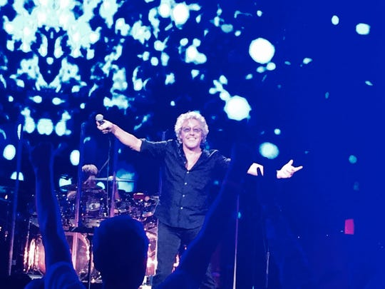 Who fan Alan McKendree of Austin raises his arms in exultation at singer Roger Daltrey performs at one of the 120 Who concerts McKendree has seen.