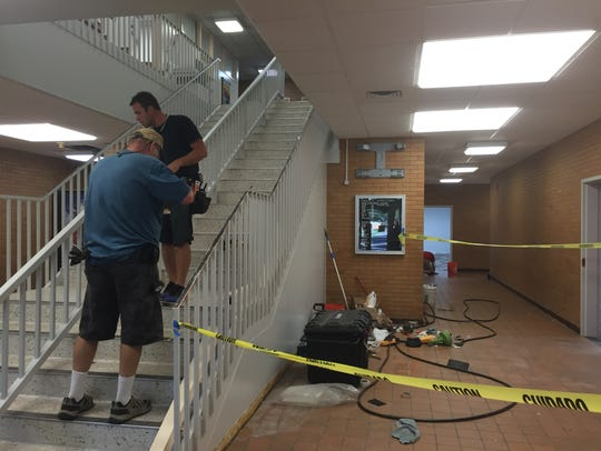 Workers push to complete a remodeling project at Dixie