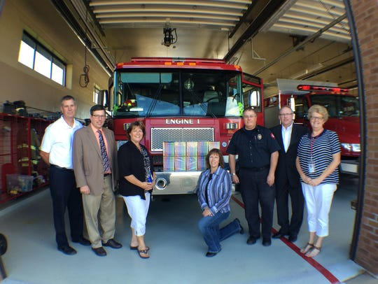 Firefighters, donator representatives and school officials