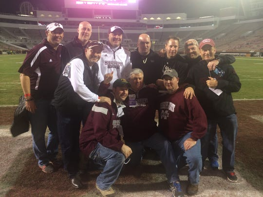 Mississippi State coach Dan Mullen poses with high school friends after a game at Davis Wade Stadium.
