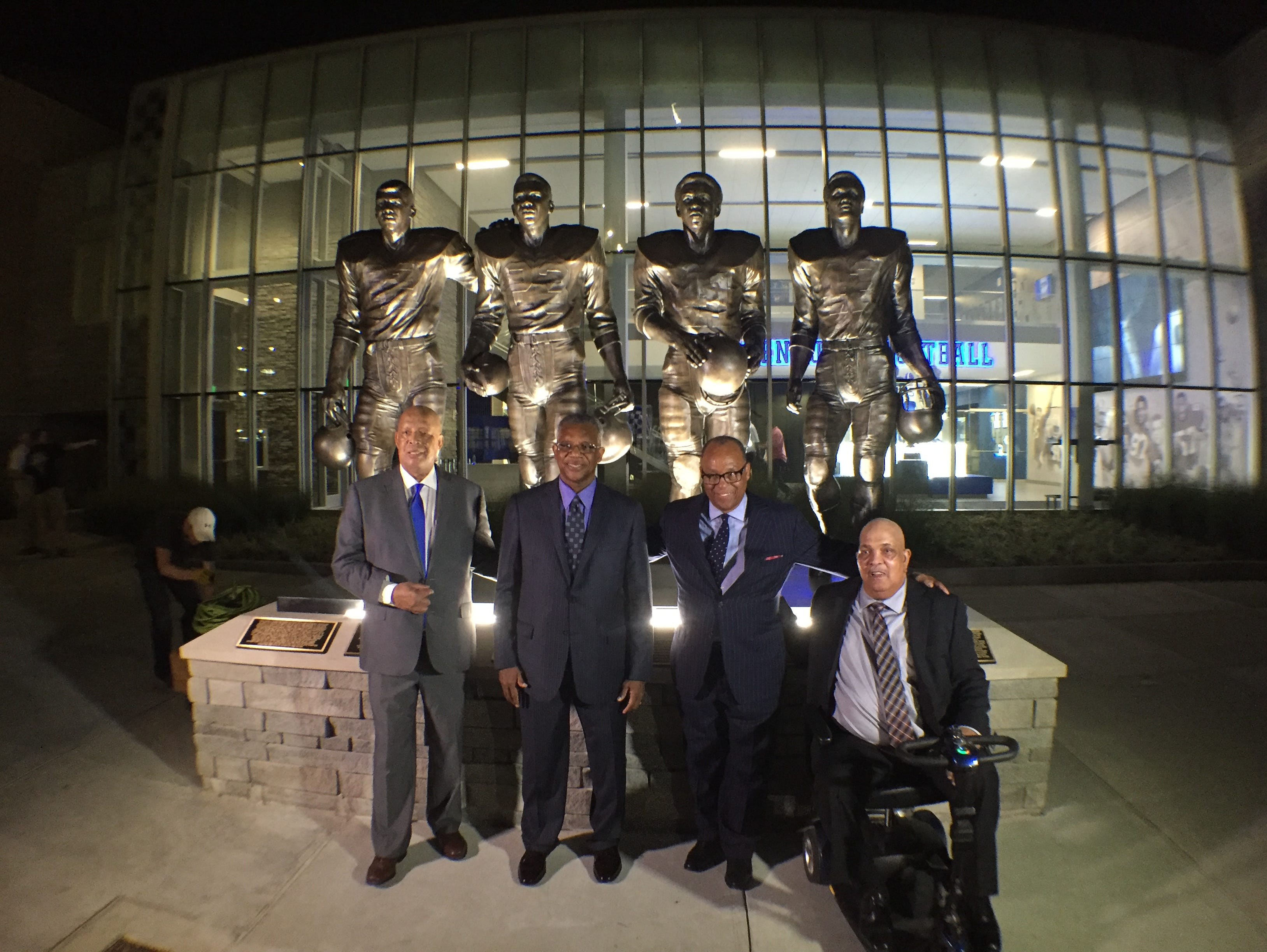 From left to right: Mel Page, Nate Northington, Wilbur Hackett and Houston Hogg pose in front of statue honoring them for breaking the SEC's color barrier