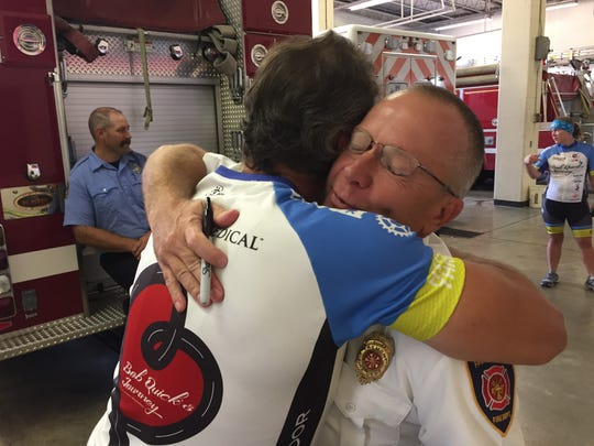 Fremont Fire Chief Dave Foos receives a hug from Bob
