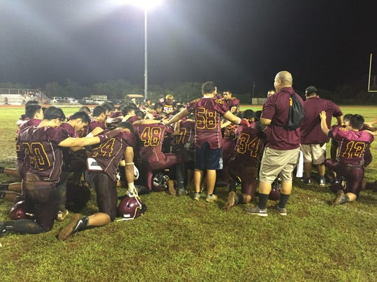 The FD Friars gather round after their 38-0 shellacking of the Sanchez Sharks Saturday in the Interscholastic Football League. The game was called early in the third quarter because the Sharks didn't have enough healthy players.