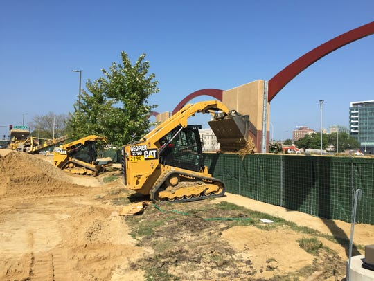 Construction crews fill temporary barriers Saturday
