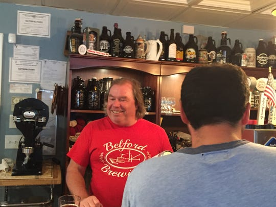 Mike Enny, co-owner of Belford Brewing Co. in Middletown, serves samples.