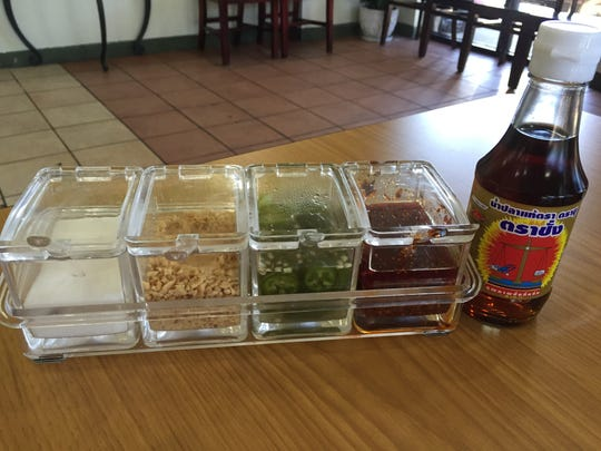 SaBaiDee Cafe brings a condiment tray to each table that includes fish sauce, sugar, crushed peanuts, pickled jalapenos and a chili pepper oil infused with garlic.