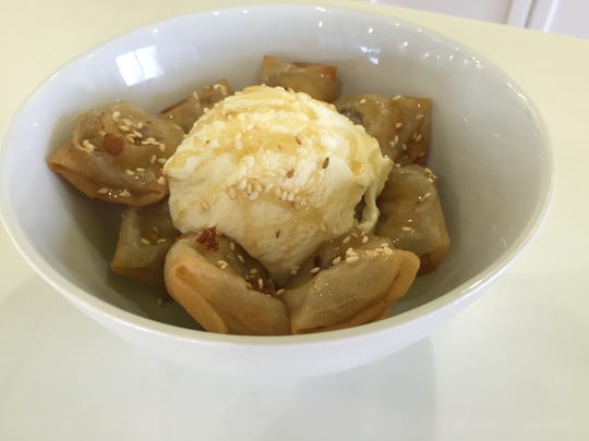 Fried bananas are served with a scoop of vanilla ice cream and drizzled with honey and sprinkled with sesame seeds at SaBaiDee Cafe in Murfreesboro.