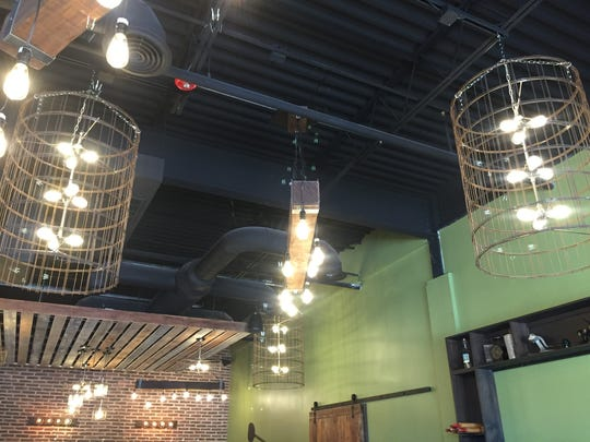 New lighting in fixtures crafted from upcycled Napa wine barrels hang above the dining room at Marino's of Mullica Hill.