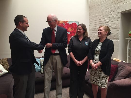 From left, Lt. Michael Warren, Dr, Joseph Hagan, medical examiner Lauri McGivern and Chittenden Child Advocacy Center Executive Director Veronica Rathgeb at 50 Cherry St. on Wednesday, Sept. 28, 2016, to promote a safe-sleeping video.