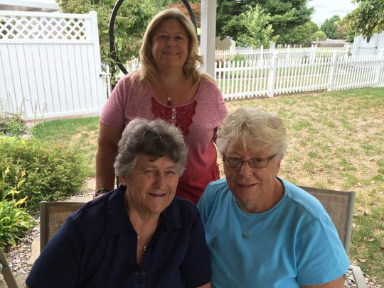 Judy Helfrick, right, seated, with her sister Sandy
