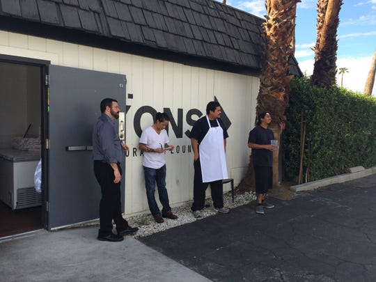 Mr. Lyons employees wait outside after a power outage shut off electricity to the Palm Springs restaurant Wednesday. The outage prevented them from preparing food for the evening.