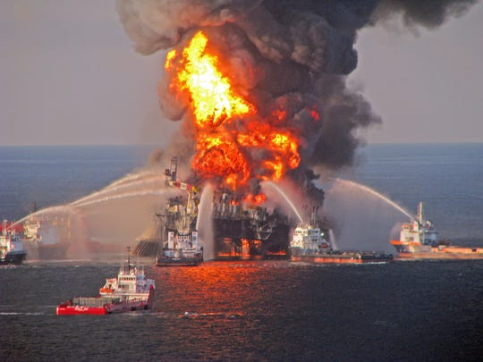 The offshore oil-drilling unit Deepwater Horizon blazed brightly after the explosion in 2010.