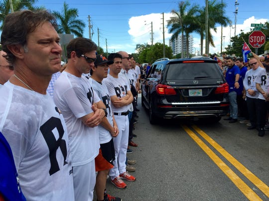Miami Marlins manager Don Mattingly and his players
