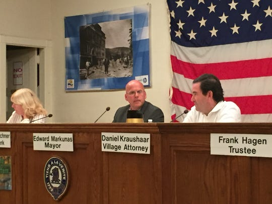 Suffern Mayor Ed Markunas, middle, sits among other village officials at the meeting with state officials at Village Hall on Sept. 27, 2016.