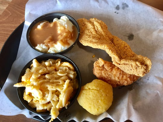 A teaser combo meal with fried fish, chicken, corn bread, bake macaroni and cheese and mashed potatoes with gravy at Sugapeach Chicken and Fish Fry in North Liberty on Sept. 25, 2016.