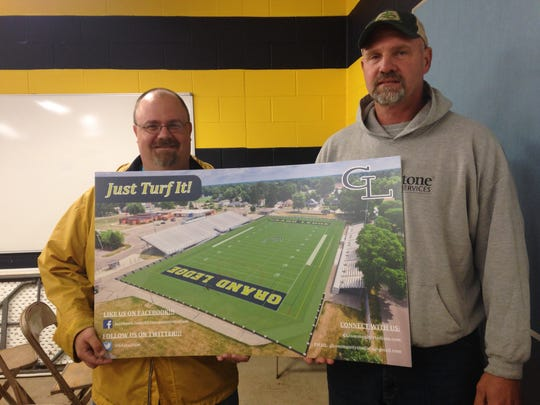"""Just Turf It!""' reads the rendering of what a community"