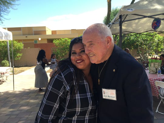 Brianna Lopez, a graduate of the Coachella Valley Rescue Mission's New Life program, gets a hug from Pastor Jack Marshall on Thursday, Sept. 29, 2016.