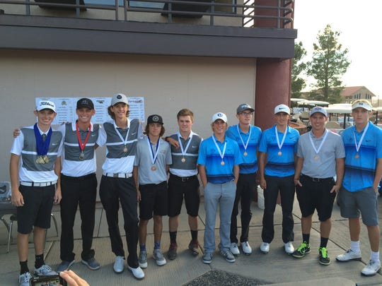 The top-10 Region 9 golfers pose for a picture after