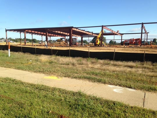 Construction continues on a new 14,000-square-foot retail center in Thomsen Farms.